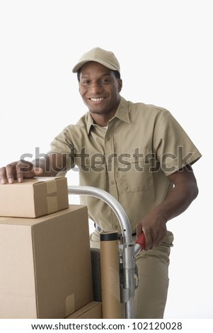 African American delivery man with hand truck - stock photo