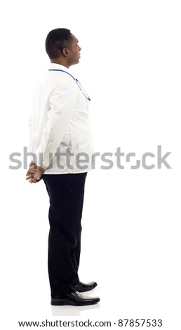 African American doctor from the back - looking at something over a white background - stock photo