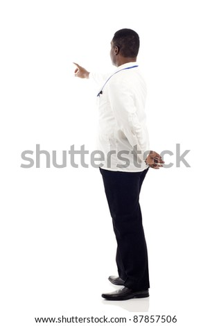 African American doctor from the back  - pointing at something over a white background