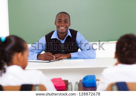 african american elementary school teacher in classroom with students