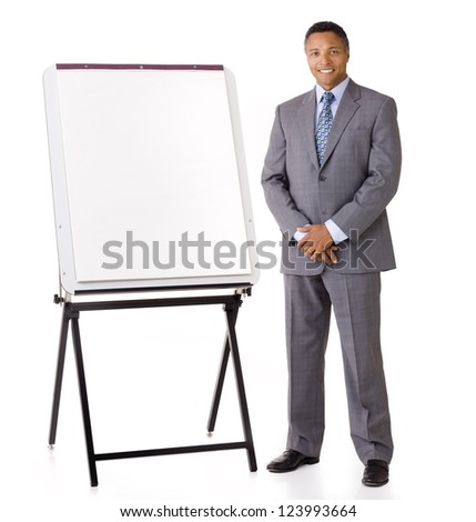 African American executive businessman smiling standing next to blank easel on white background hands folded