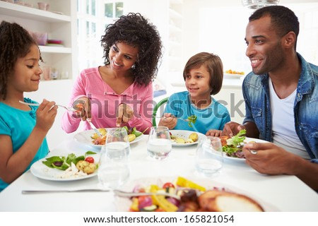 African American Family Eating Meal At Home Together - stock photo