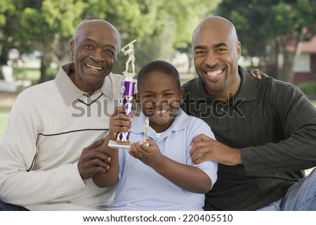African American family with trophy outdoors - stock photo
