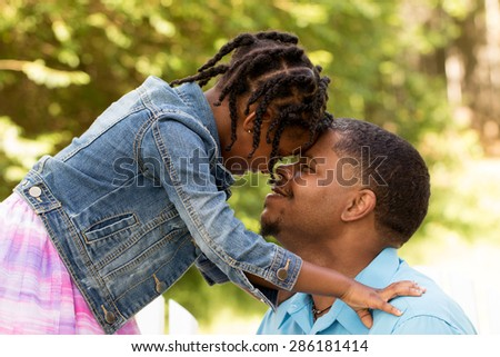 African American father and daughter - stock photo
