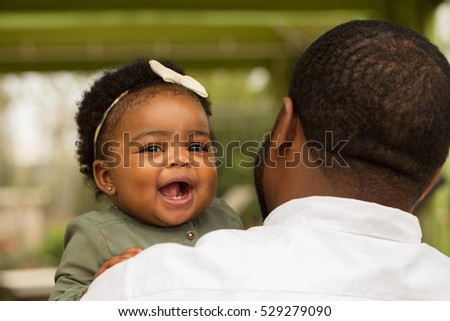 African American father and his little girl.