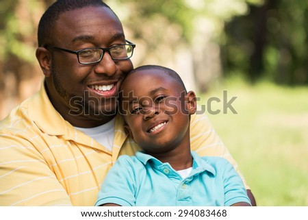 African American Father and son - stock photo