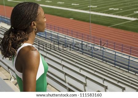 African American female athlete in stadium looking away - stock photo
