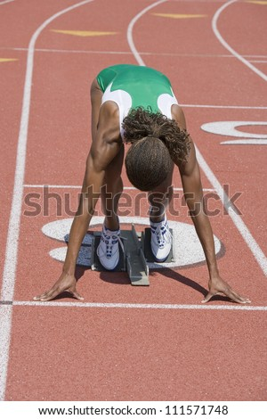 African American female athlete ready to start race - stock photo