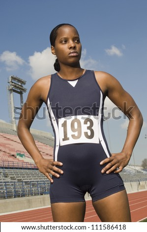 African American female athlete standing on racing track