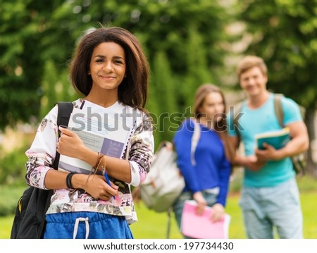 African-american girl student in a city park on summer day