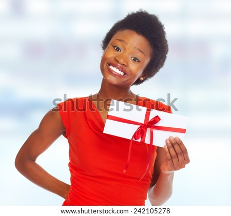 African-American girl with gift envelope. over blue background - stock photo