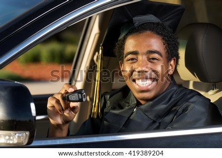 African American graduate with a new car - stock photo