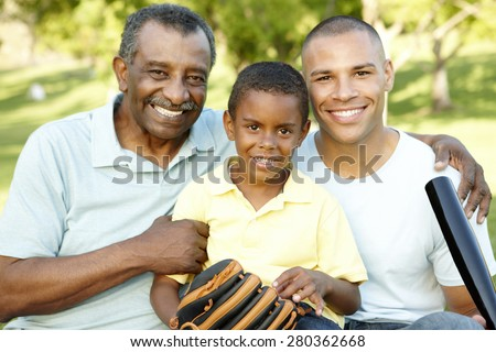 African American Grandfather, Father And Son Playing Baseball In Park - stock photo