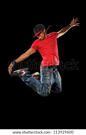 African American hip hop dancer jumping isolated over black background