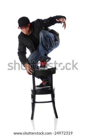 African American hip hop dancer on chair - stock photo