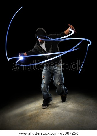 African American hip hop dancer with LED lights painting patterns