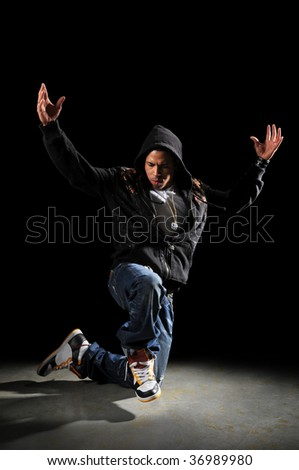 African American hip hop man dancing over dark background - stock photo