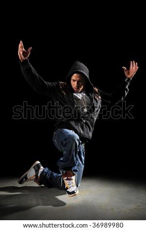 African American hip hop man dancing over dark background - stock photo