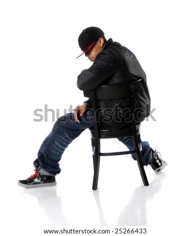 African American hip hop man sitting on chair - stock photo