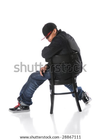 African American hip hop man sitting on chair over a white background - stock photo
