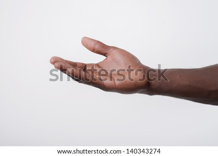 African-American holds open palm - stock photo