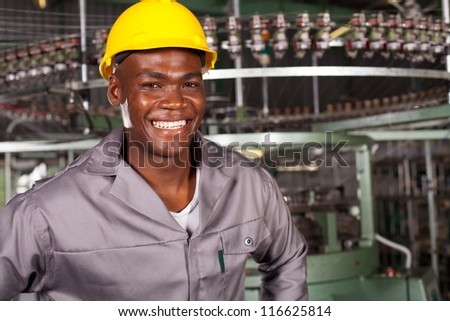 african american industrial worker portrait in front of machine - stock photo