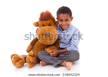 African American little boy holding a plush, isolated on white background - Black people