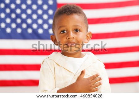 African-American little boy with American flag on a background