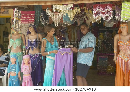 African American looking at belly dancing outfits - stock photo