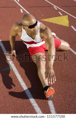 African American male athlete warming up before race
