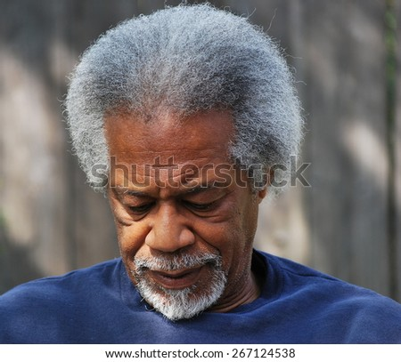 African american male expressions alone outside. - stock photo
