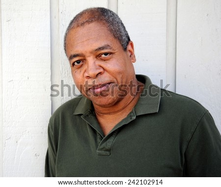 African american male expressions outside against a wall. - stock photo