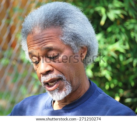 African american male expressions outside alone. - stock photo