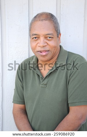 African american male expressions standing alone outside. - stock photo