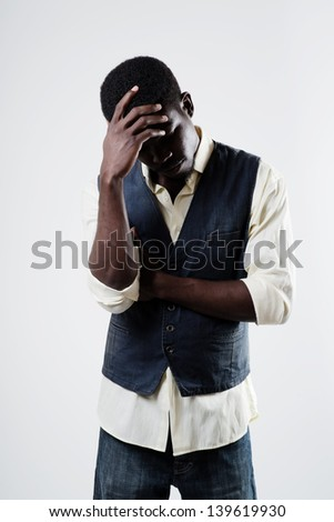 African american male feeling sad and rejected outdoors - stock photo