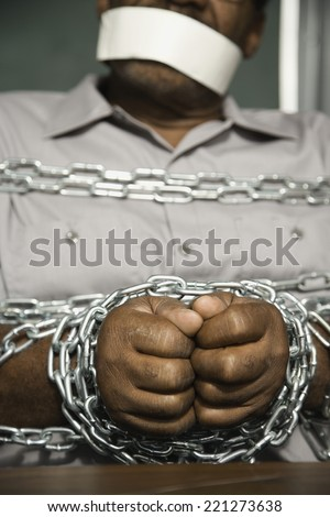 African American man chained and gagged - stock photo