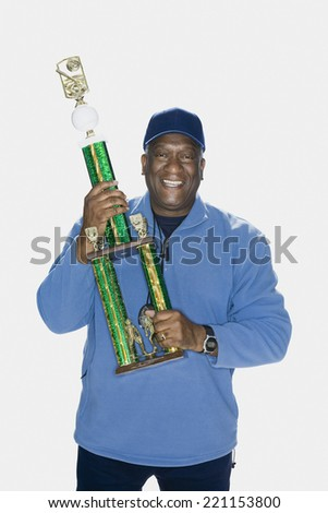 African American man holding trophy - stock photo