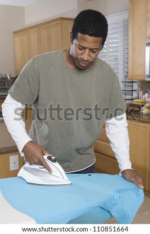 African American Man Ironing - stock photo