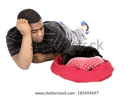 African American man laying with puppy dog