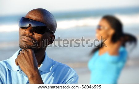 African American man looks out at the beach - stock photo