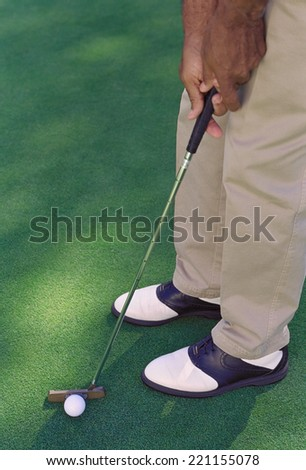 African American man playing golf - stock photo