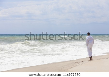 African American man standing alone on a tropical beach
