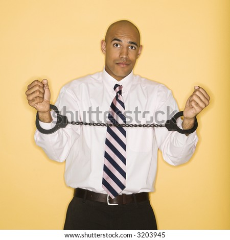 African American man wearing handcuffs. - stock photo