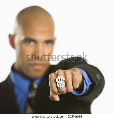African American man wearing ring with money sign. - stock photo