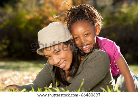 African American mother and child having fun spending time together