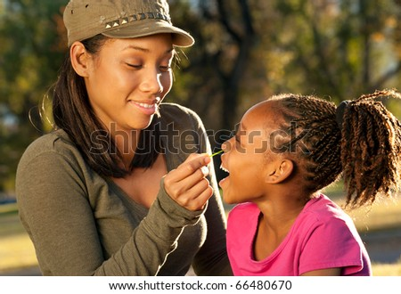 African American mother and child playing together