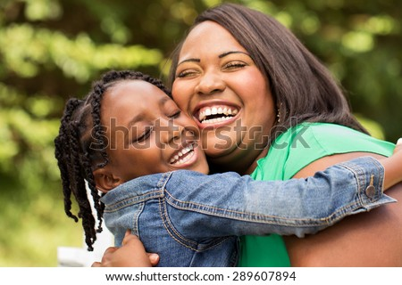 African American mother and daughter. - stock photo