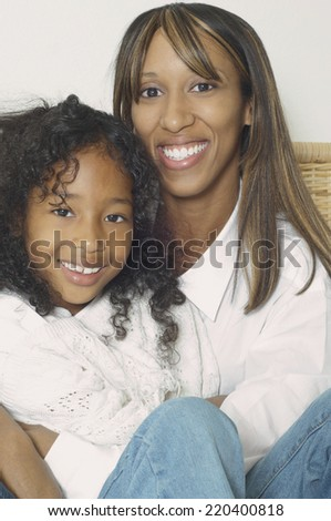African American mother and daughter smiling - stock photo