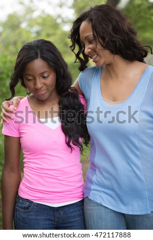 African American mother and her teenage daughter.