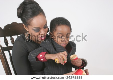 African american mother playing with her son